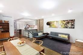 2 bedroom apartment new york city vacation rentals. image of an open apartment living area with a kitchen, dining table and decorative colors 2 bedroom new york city vacation rentals