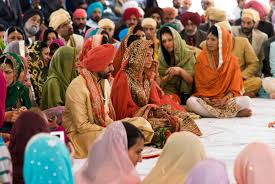 this sikh couple awaits their wedding ceremony