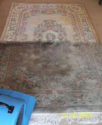halfway through the cleanign and restoration of an oriental rug in colchester ct