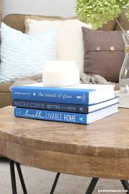 rustic round wood coffee table with blue interior design coffee table books with a candle and