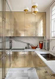 Gold Cabinets Gold glam kitchen with carrara marble back splash, counter  tops, and tiled floor! MCM light fixture to die for.