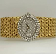 bueche girod lady s yellow gold and diamond wide bracelet watch at bueche girod lady s yellow gold and diamond wide bracelet watch 2