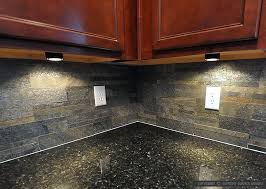 black countertop slate brick backsplash tile