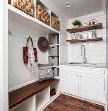 stacked wooden floating shelves over laundry sink