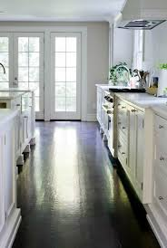 white kitchen cabinets with dark hardwood floors