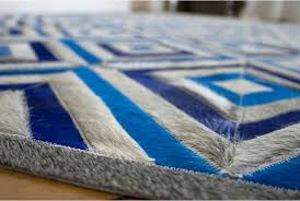 floor view of a blue and gray diamond patchwork cowhide rug royal design no