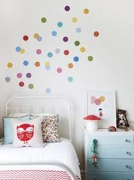 rainbow polka dot decals on white wall