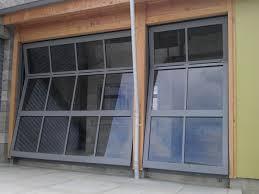 bi fold garage doorsBi Fold Garage Doors 2  barn doors  Pinterest  Barn garage