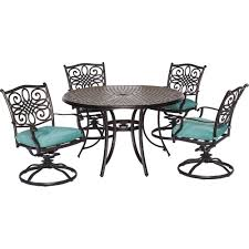 traditions 5 piece outdoor round patio dining set and 4 swivel rockers with blue cushions