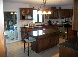 small wooden kitchen island with seating featuring traditional kitchen island lighting