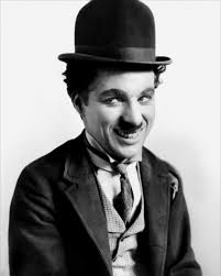 charlie chaplin filmography  a smiling man a small moustache wearing a bowler hat and a tight fitting charlie chaplin