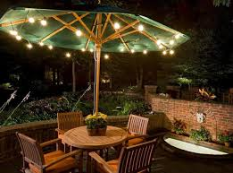 creative patio lighting ideas with outdoor patio furniture set and green umbrella