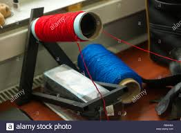 Bobbins Design Two Big Bobbins With Large Mating Colored Threads In The