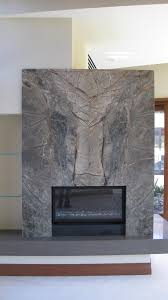 book matched stone fireplace wall and slab stone hearth with a mitered edge