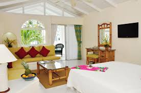 Awesome Bedroom And Living In One Room With Red Pillow On Green Sofa Also  Bamboo Furniture