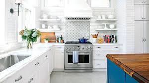 all white kitchen bright and airy backsplash tile beveled arabesque