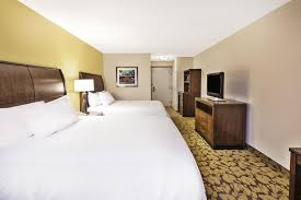 a bed or beds in a room at hilton garden inn cleveland downtown