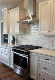 white kitchen long subway tile