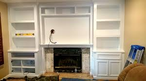 fireplace wall unit with bookcases in white lacquer 4