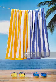 hanging beach towel. Beach Towels Hanging Above Sandals On Deck Towel 3