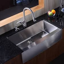 simple kitchen with composite black granite kitchen countertops stainless steel farmhouse sink and stainless