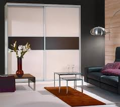 sliding doors with melamine panels in tuxedo and ivory aluminum hardware