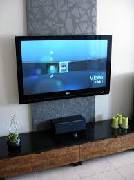 17 best ideas about hide tv cables hide cable cords panel inspiration for tv wall mount i ll build a wood frame stretch canvas over it to hide the mounting unit and cables don t like the pattern but it s