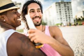 men drinking beers at the party beach in fl