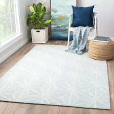 light blue white geometric indoor outdoor area rug x and striped