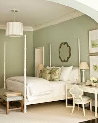 bedroom colors green. a palette of light blue and beige-y colors makes this master bedroom both restful green