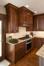 stained kitchen cabinets in pecan with ebony glaze by showplace cabinetry view 3