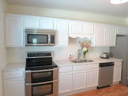 white kitchen cabinets with granite countertops. Inspiring Plenteous White Kitchen Cabinet And Beauteous Backsplash Wooden Floors Installation In Decors Cabinets With Granite Countertops