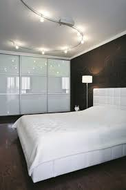 track lighting bedroom. Simple Lighting Minimalist Modern Bedroom With Track Lighting Fixtures Over The Throughout M