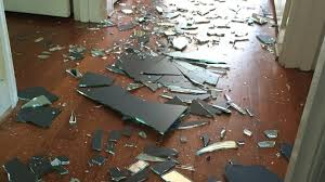 her young son in a fit of anger slammed the bathroom door which led the bathroom s mirror to fall to the ground and shatter