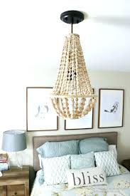 small beaded chandelier how to make a wood bead chandelier wood bead chandelier come learn how