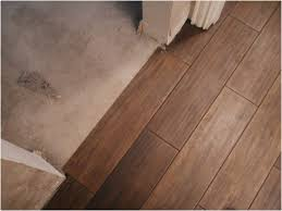 hardwood flooring over ceramic tile stock that looks like floors unique floor of dark wood porcelain