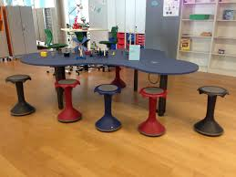 kids at classroom table. vs hokki stools around puzzle table are used for small group instruction. the slight wiggle in base keeps active kids engage. at classroom n