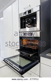 open oven in kitchen. modern hi-tek kitchen, oven with door open - stock photo in kitchen v