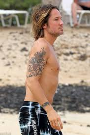 Shirtless Keith Urban shows Nicole Kidman tattoo in Hawaii as she ... via Relatably.com