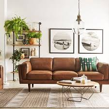 tan leather sofa with pendant light