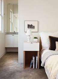 narrow bedside table Bedroom Transitional with bed bedding concrete floor  guest