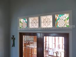 four decorative transom windows above a set of french doors