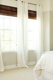 SW Worldly Gray band and ceiling Swiss Coffee by Dunn Edward. Bamboo shades  and simple white curtains