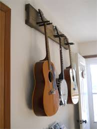 diy guitar hanger simple secure we practice so much more since these many pictures of free wooden guitar rack plans