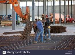 laying rebar for concrete reinforcement stock image rebar worker