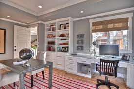 gorgeous striped rug in red brings color to this traditional home office in gray design