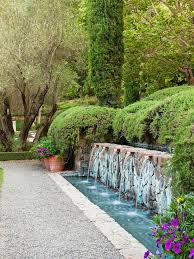 add drama to a retaining wall water feature