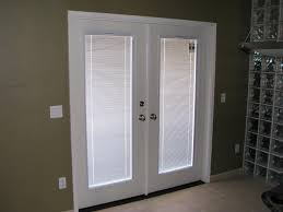 white exterior door with blinds between glass
