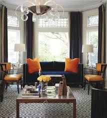 blue sofas living room: smythe combined deco lighting with on trend colours and patterns to update the classic lines of this room solid upholstery including punchy orange pillows