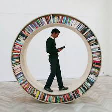 Designer David Garcia made this circular bookcase that the reader can use  for both storage and transportation: